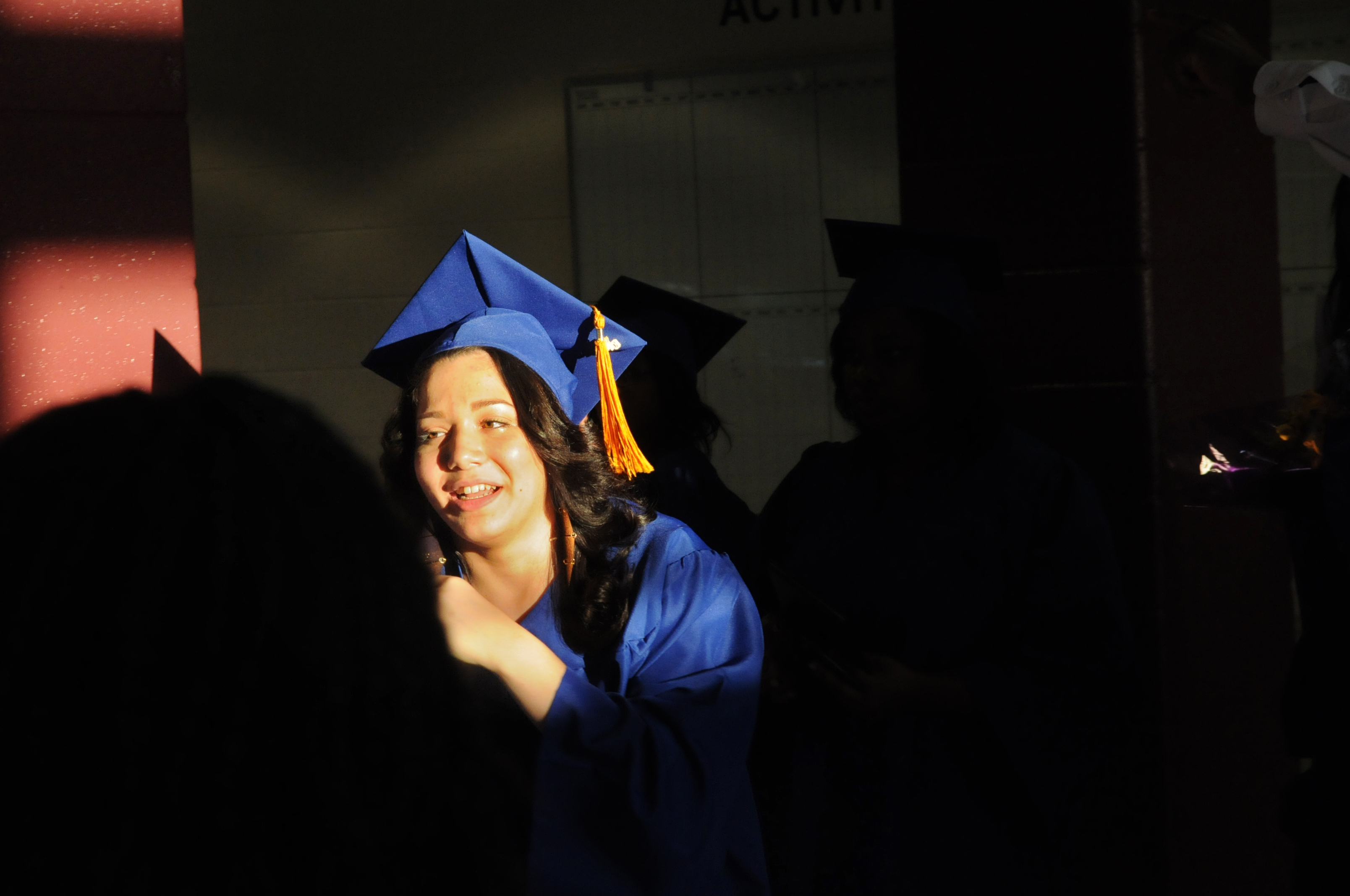 Lianmarie Rodriguez, 17, leaves the school to meet her family and friends after the ceremony.