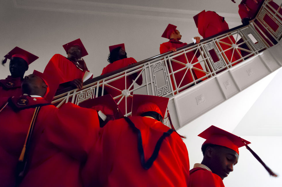2013.06.12 - Hartford, CT - High School, Inc. students crowd a stairwell before entering the Aetna auditorium for the commencement. Photograph by Mark Mirko | mmirko@courant.com