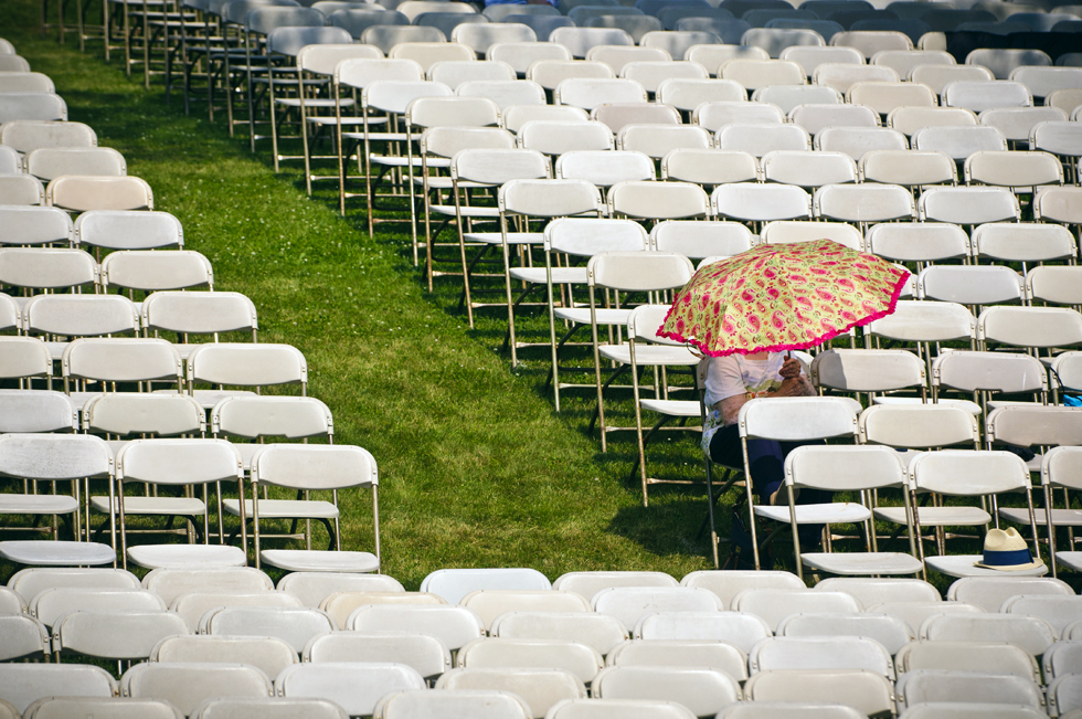 2013.06.24 - West Hartford, CT - Arriving more than an hour before the start of Hall High School's commencement ceremony, Eva Fonseca stakes out seats for herself and eight family members to see her grandson, Matthew Kalinowski, graduate.  Photograph by Mark Mirko | mmirko@courant.com