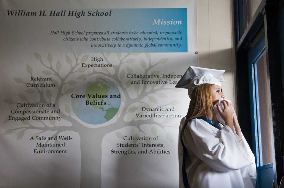 2013.06.24 - West Hartford, CT - Erin Smyth gazes out the window of a Hall High School door eagerly waiting to see a family member prior to the school's graduation ceremony.  Photograph by Mark Mirko | mmirko@courant.com