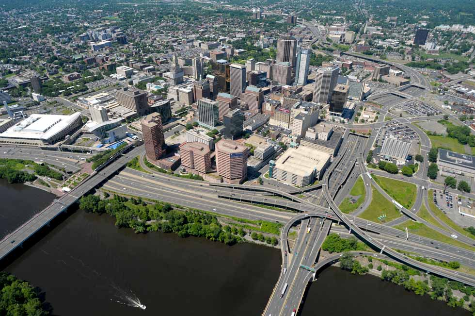 This photograph of the Hartford skyline taken from the MetLife blimp looks to the west from above the Connecticut River. The MetLife blimp provides video for the PGA tour and marketing for the nation's largest life insurer.