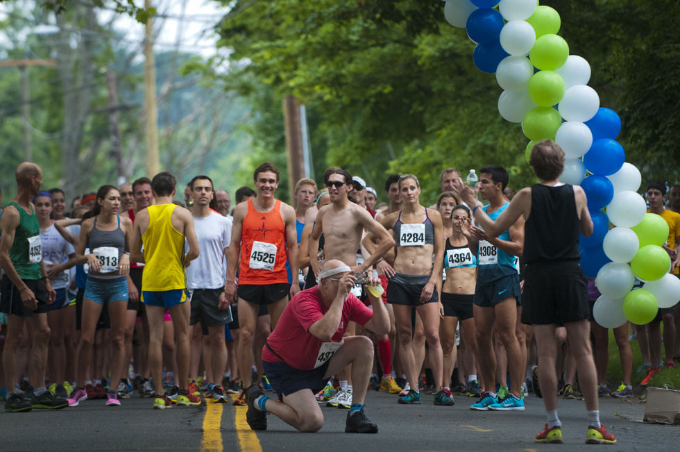 2013.06.30 - Middletown, CT - Ron Boucher of Burlington, Vt, photographs running legend Bill Rogers in the final minute before the start of the Legends Run. This was the first year of the race that organizers hope to make an annual event. Photograph by Mark Mirko   mmirko@courant.com