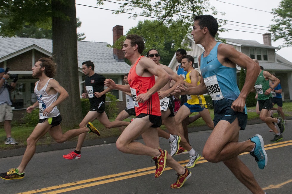 2013.06.30 - Middletown, CT - Glastonbury Olympian Donn Cabral (blue tank) looks past Christopher Zablocki (red tank) to Everett Hackett (L) of West Hartford, CT, as William Sanders (dark glasses) eyes Cabral in the first hundred yards of the 4-mile Legends Run. Cabral won the race with a time of 19:28, Zablocki finished second with a time of 19:36, Hackett finished fifth with a time of 20:36, and Sanders finished fourth with a time of 00:20:18. Photograph by Mark Mirko   mmirko@courant.com