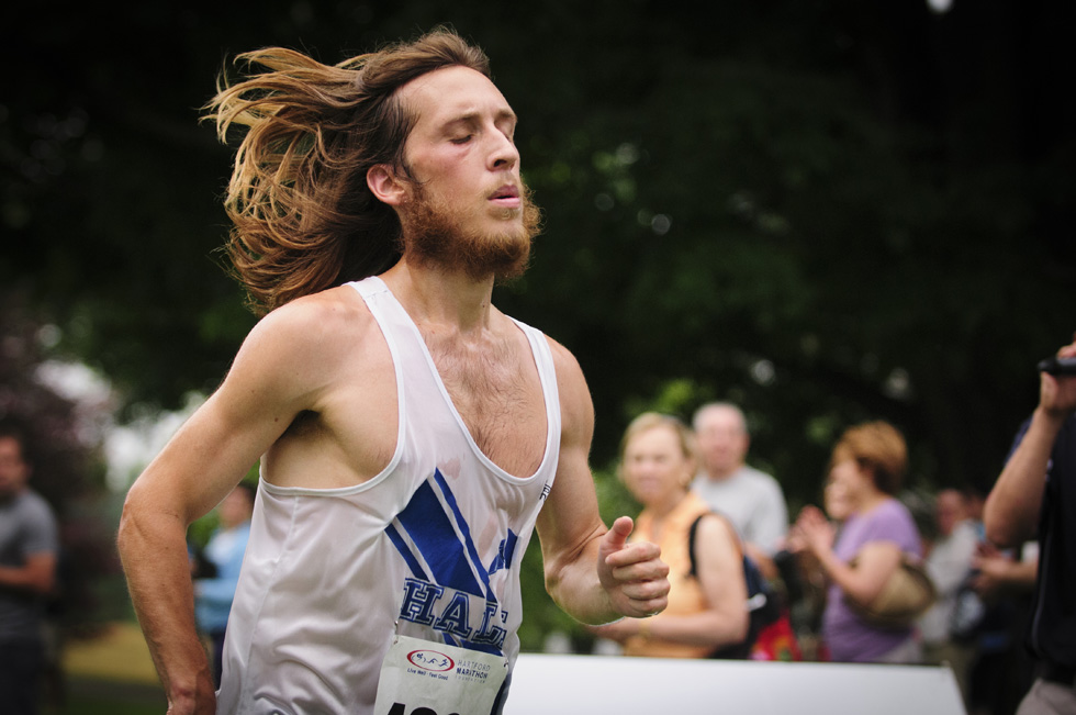 2013.06.30 - Middletown, CT - Everett Hackett of West Hartford closes in on the finish line during his 00:20:36 time in the four-mile race. Hackett placed fifth overall. Photograph by Mark Mirko | mmirko@courant.com