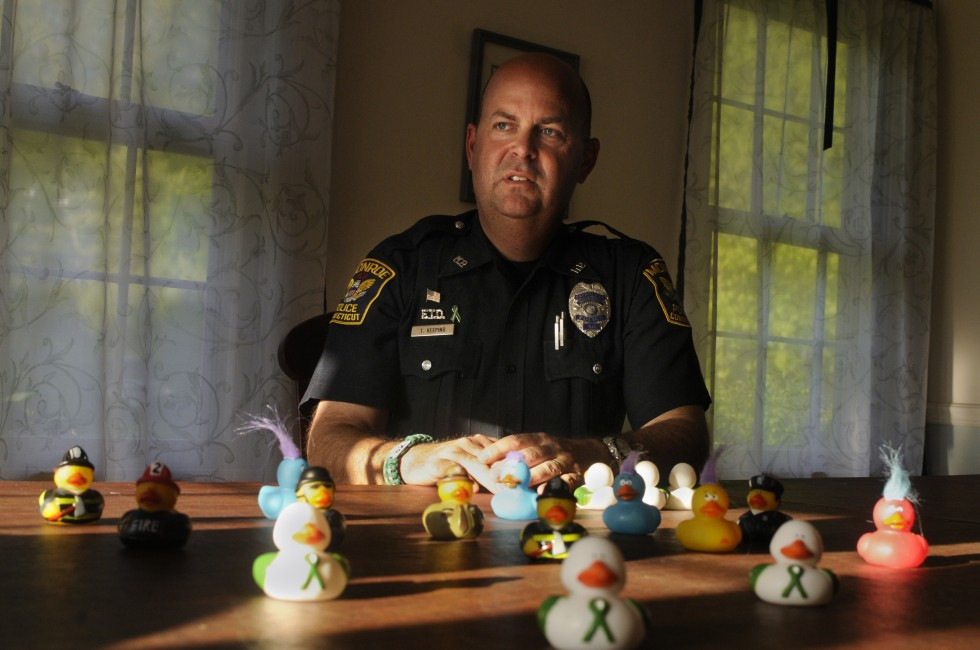Monroe Police Officer Todd Keeping has been patrolling the halls of Chalk Hill Elementary School since it opened as the new Sandy Hook School in January. Keeping, who lives in Sandy Hook, requested the assignment. As the school opened, he and other officers started to hand out rubber ducks that were donated to the school. The ducks have since served to ease the tension and become a major phenomena in town. The kids love them. A Facebook page has about 10,000 likes and they have photos of the ducks with President Obama, Gov. Malloy, and in places all around the world.