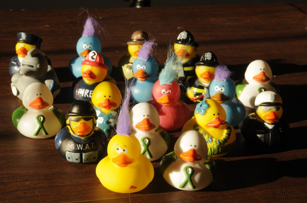 Some of the rubber ducks Monroe Police Officer Todd Keeping and his partners have been handing out to students in the converted Chalk Hill Elementary School which is acting as the interim Sandy Hook School, sit on the table in Keepings home.