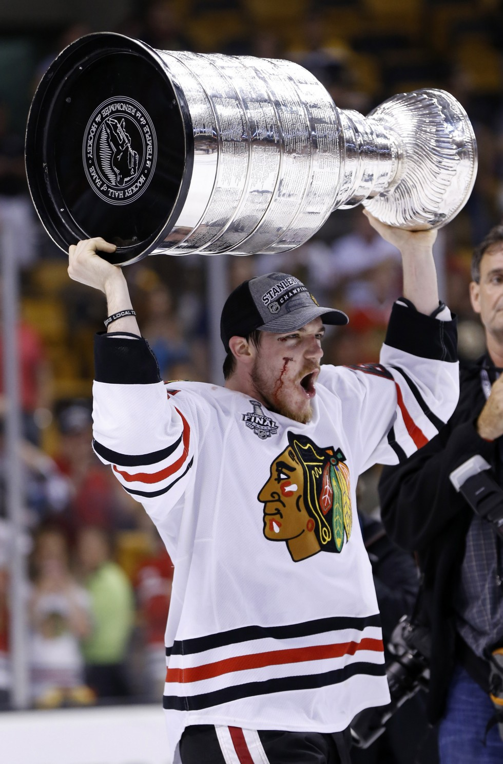 Jun 24, 2013; Boston, MA, USA; Chicago Blackhawks center Andrew Shaw hoists the Stanley Cup after game six of the 2013 Stanley Cup Final against the Boston Bruins at TD Garden. The Blackhawks won 3-2 to win the series four games to two. Mandatory Credit: Greg M. Cooper-USA TODAY Sports