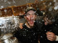Andrew Shaw of the Chicago Blackhawks celebrates with the Stanley Cup in the locker room after his team defeated the Boston Bruins in Game Six of their NHL Stanley Cup Finals hockey series in Boston, Massachusetts June 24, 2013. REUTERS/Dave Sandford/Pool