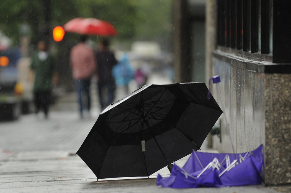 2013.06.07 - Hartford, CT - Umbrellas sit outside Burger King in downtown Hartford as heavy rain from Storm Andrea falls.