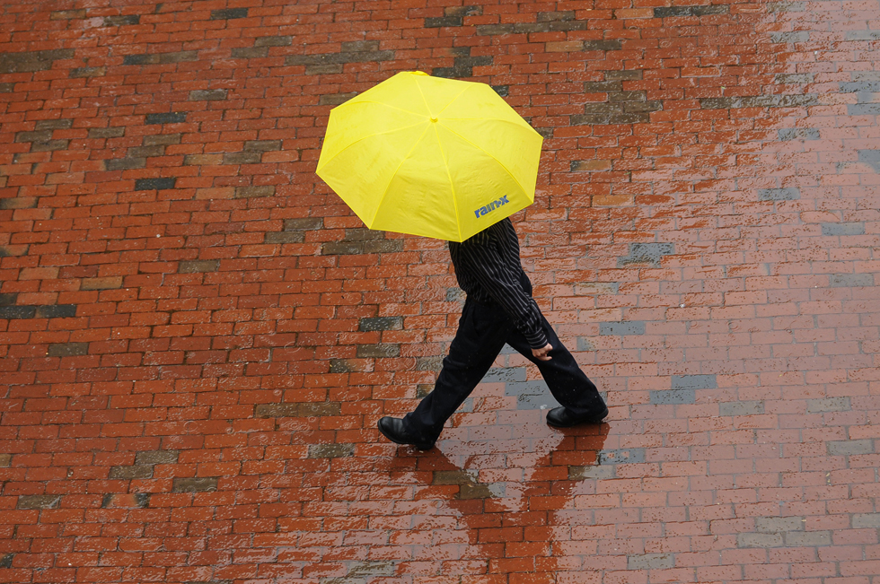 2013.06.07 - Hartford, CT - A man walks through the rain near the Old State House in downtown Hartford during Storm Andrea.