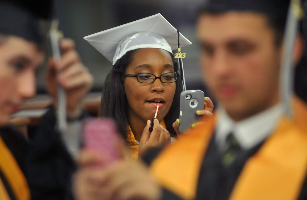 2013.06.15 - Hartford, CT - Sydney Jackson applies lip gloss prior to the Classical Magnet School graduation Saturday. BRAD HORRIGAN | bhorrigan@courant.com