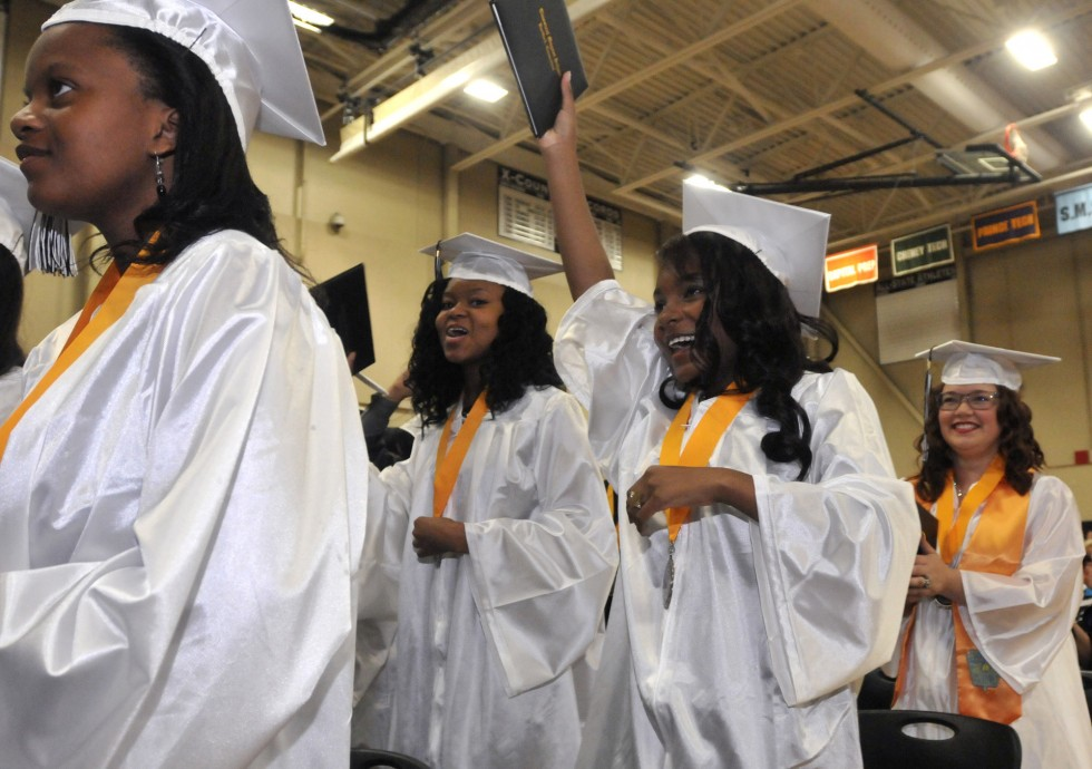 2013.06.15 - Hartford, CT - Graduating seniors Nikesha Reid, second from left, and Shanique Reid, second from right, raise their diplomas in celebration at Classical Magnet School graduation Saturday. BRAD HORRIGAN | bhorrigan@courant.com