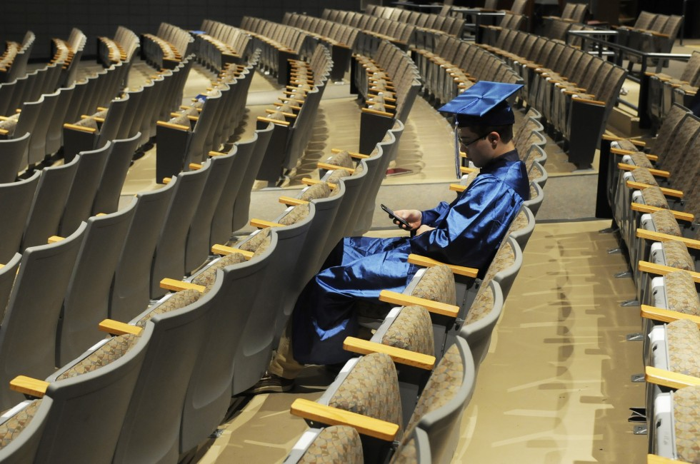 Robert Koolis, 17, arrived early to graduation and was texting his brother and friend as he waited for other graduates. Koolis said he plans to attend Keene State College in New hampshire.