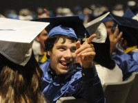 Jacob Jones, 17, acknowledges his Math teacher as the teachers exited the auditorium on the way to the ceremony before the students. Jones said he pals to attend UConn and major in English.