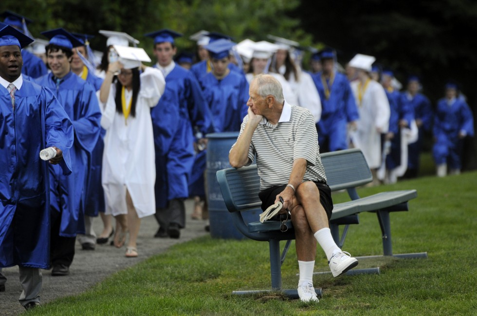 George Uhl, watches the 2013 Glastonbury High School processional looking for his granddaughter Amanda Lunsford, who is graduating and headed to UConn. Uhl, a graduate of UConn himself, said all of his children also graduated from the University.