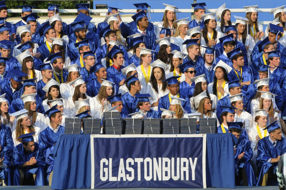 Graduates listen to a speaker during the commencement exercises.