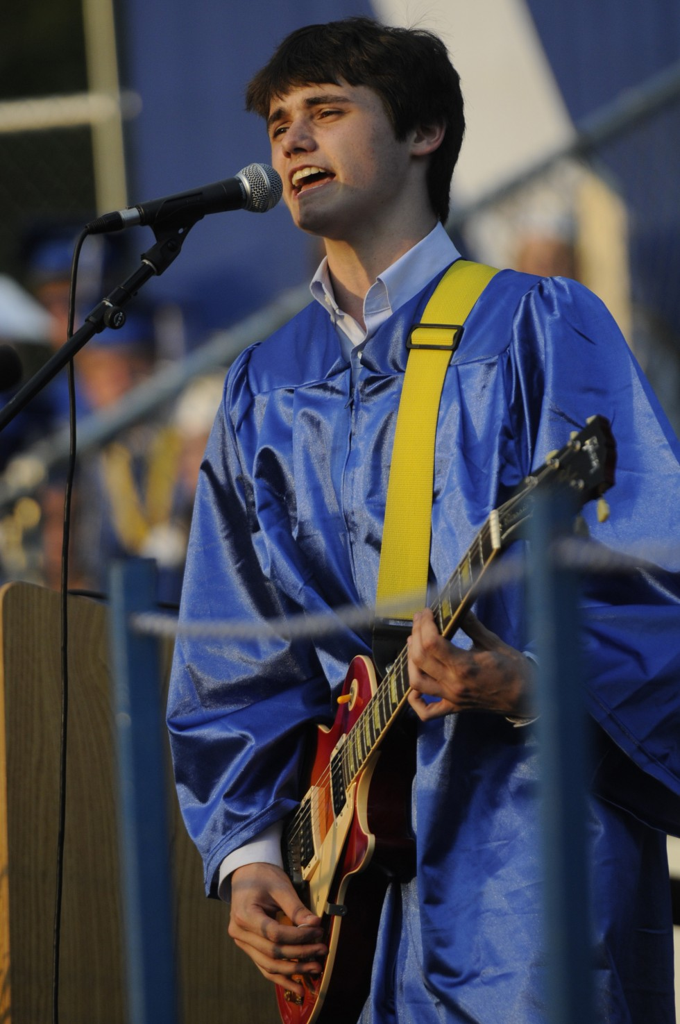 "Nicholas Nordlund, who graduated first in his class and plans to attend Yale, sings lead in a performance of ""we Are The Champions,"" by Freddie Mercury."