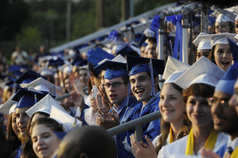 Members of the class applaud a musical performance by their fellow students before degrees were handed out.