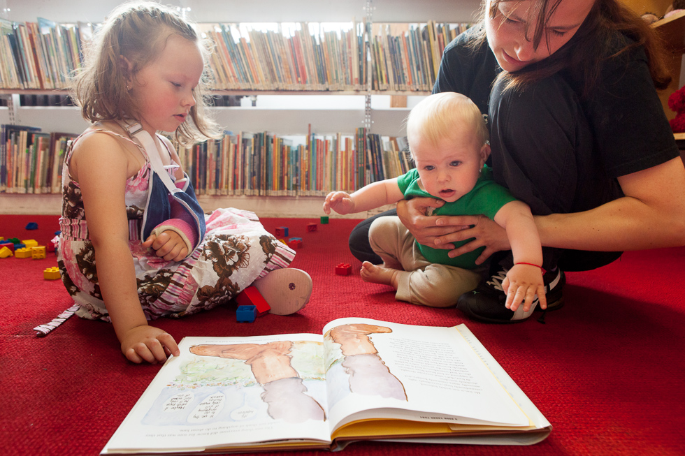"2013.06.18 - New Britain, CT - Maria Kovalska (right) of New Britain, reads a book to her daughter Amelia Kovalska, 5, and her son Alan Kovalska, 10 month. ""I love that they have lots of things for the kids (at the library),"" says Kovalska, originally from Ukraine, whose family has enjoyed multiple programs available at the library. Photograph by Will Parson 