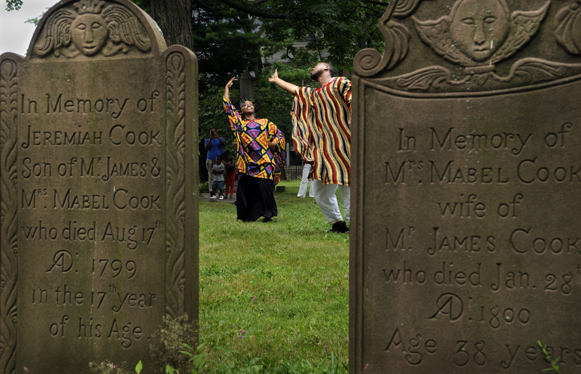 Melissa Craig of Hartford, left, and Robert Byrd of New Haven, performed an African dance among the ancient gravestones during their performance. More than two dozen attended the interactive performance.