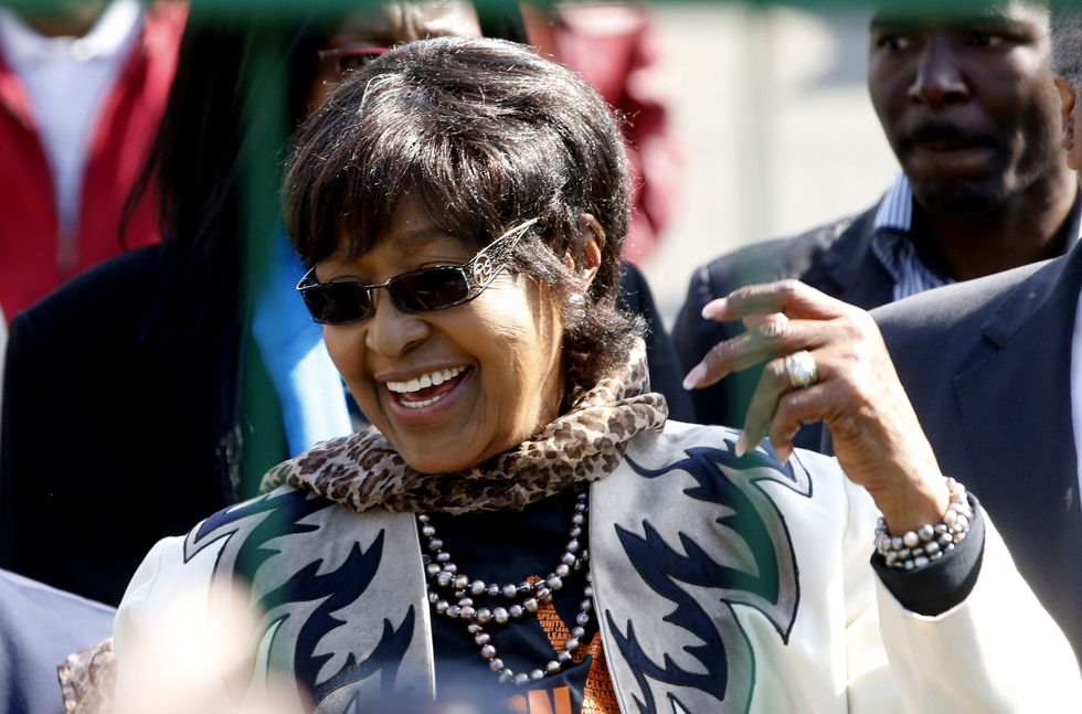 Winnie Madikizela-Mandela greets well-wishers who gathered to celebrate Nelson Mandela's 95th birthday. REUTERS/Mike Hutchings