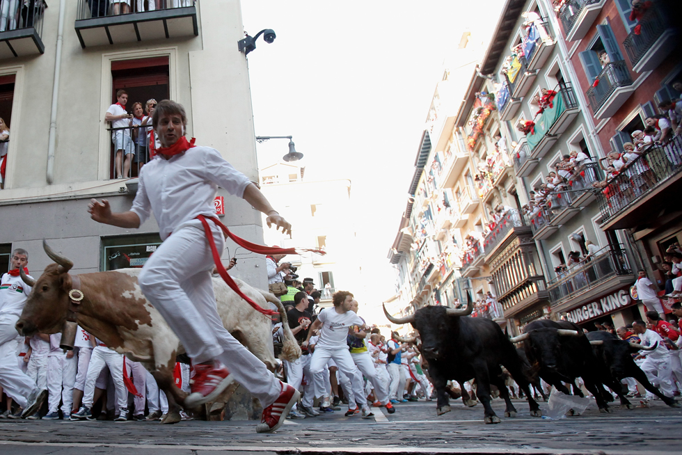 Runners try to escape the impending bulls on the third day of the San Fermin Running Of The Bulls festival, on July 8, 2013 in Pamplona, Spain.  (Photo by Pablo Blazquez Dominguez/Getty Images)