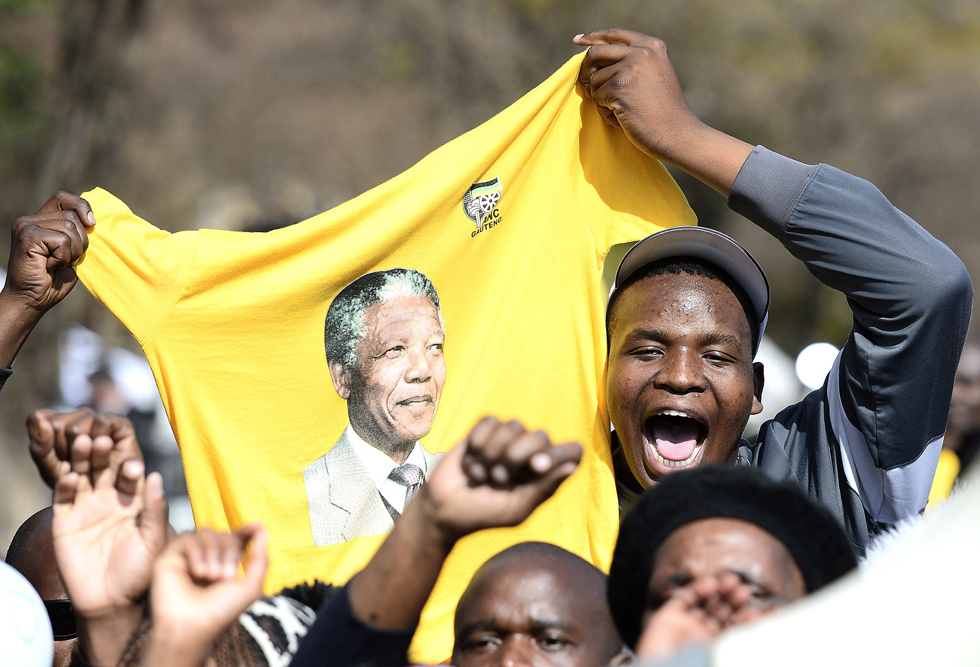 Well-wishers celebrate the birthday of former South African President Nelson Mandela on July 18, 2013. The United Nations declared the Nobel Peace laureate's birthday Mandela Day in 2010, but for many this year it takes on extra poignancy. AFP/ STEPHANE DE SAKUTIN/AFP/Getty Images