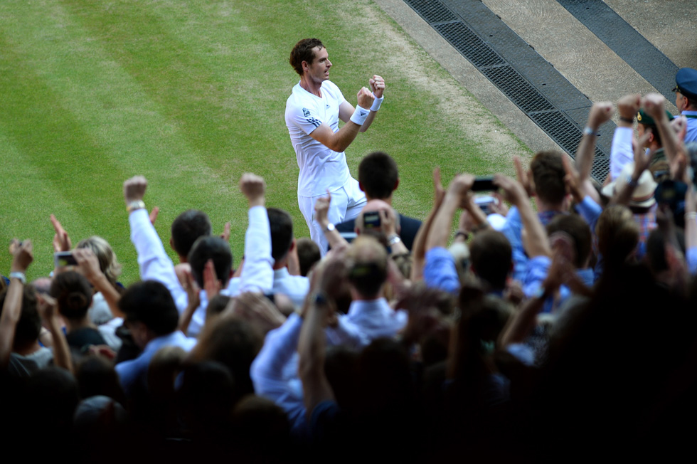 Wimbledon champion Andy Murray turns to his fans after he beat Novak Djokovic, July 7, 2013 in London, England.  (Photo by Mike Hewitt/Getty Images)