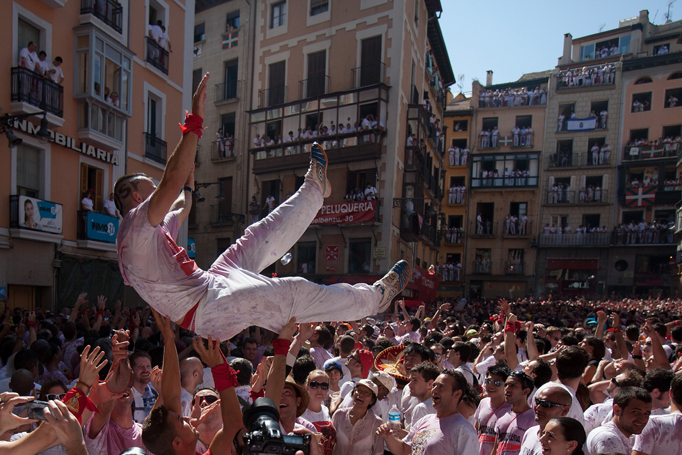 Revellers celebrate during the opening day or 'Chupinazo', of the San Fermin Running of the Bulls fiesta, July 6, 2013, in Pamplona, Spain. The annual Fiesta de San Fermin, made famous by the 1926 novel of US writer Ernest Hemmingway entitled 'The Sun Also Rises,' involves the running of the bulls through the historic heart of Pamplona. (Photo by Pablo Blazquez Dominguez/Getty Images)
