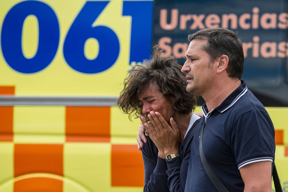 Relatives of passengers involved in the train crash wait for news at the Cersia Building in Santiago de Compostela, Spain. The train, which was traveling at excessive speed, derailed and caught fire as it approached the city. (Photo by David Ramos/Getty Images)