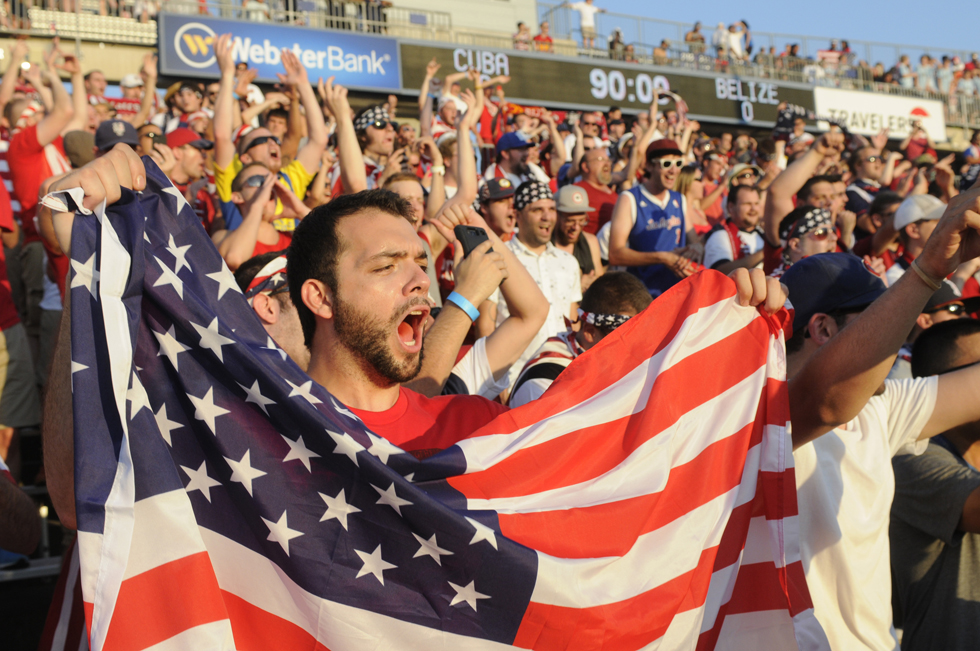 Evan Kragouras, of Bethpage NY, a member of the Long Island chapter of the American Outlaws, cheers in the stands before the game 2013 CONCACAF GoldCup soccer game at Rentschler Field in East Hartford. Richard Messina|rmessina@courant.com