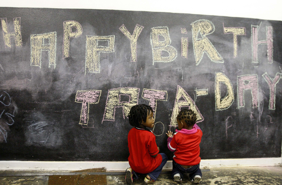 Children from a Johannesburg creche sit before a chalk board with a message wishing former President Nelson Mandela a happy 95th birthday, July 18, 2013. REUTERS/Mujahid Safodien