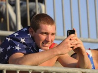 Jake Picard, 19, of Suffield, uses his smart phone before the 2013 CONCACAF GoldCup games at Rentschler Field in East Hartford. to the game with group of Suffield. soccer players that he coaches. Richard Messina|rmessina@courant.com