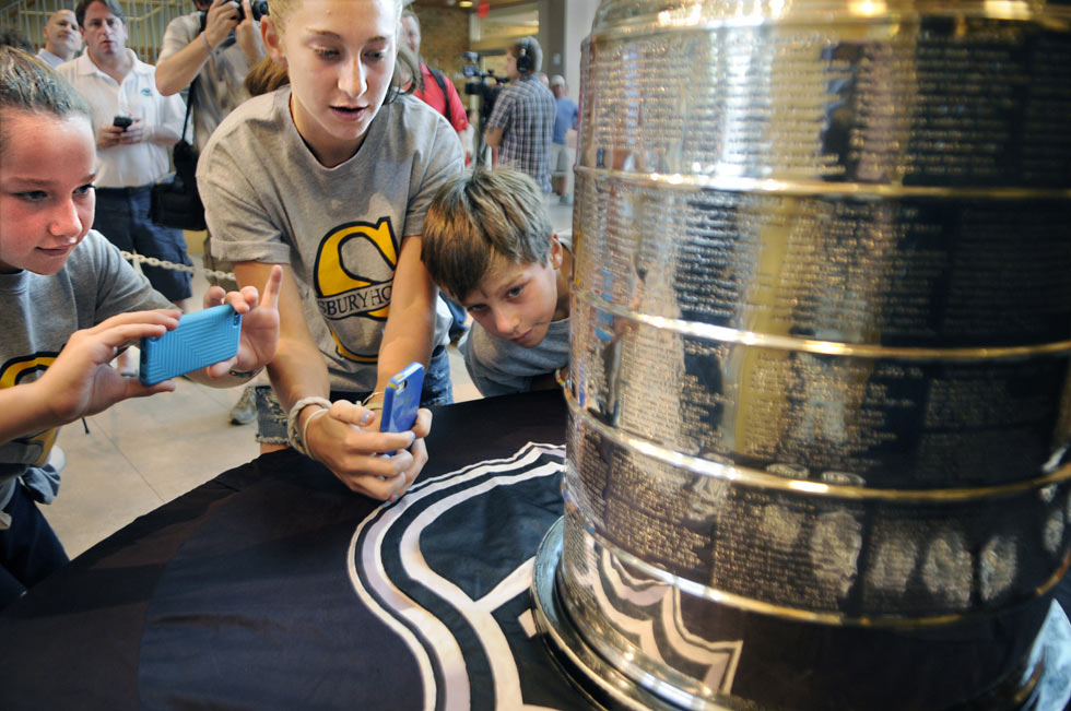 Getting up close and personal with the Stanley Cup are, left to right, Isabella Livingston, 12, Miranda Livingstone, 14, and Elijah Livingston, 10, all Simsbury Youth Hockey players, during an event at the Westminster School Tuesday morning.