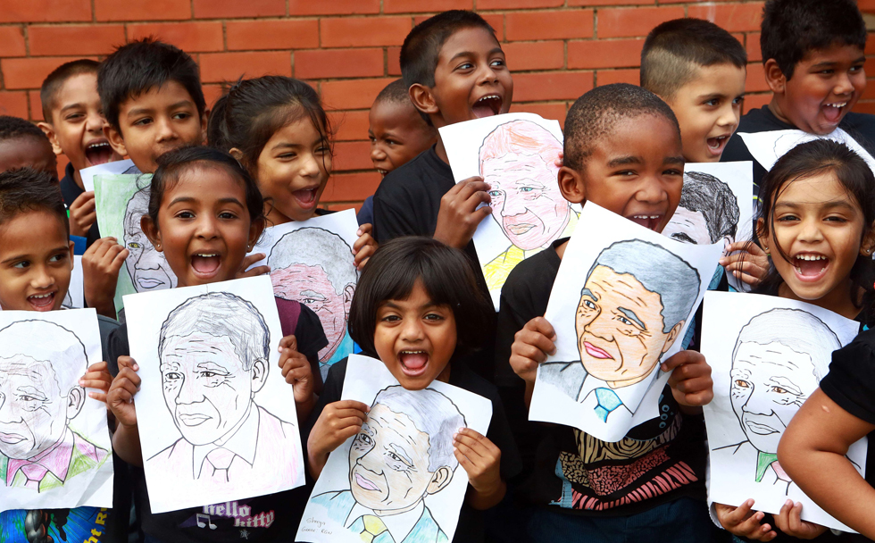 "Children from Northlen Primary school in Durban sing ""Happy Birthday"" to former South Africa President Nelson Mandela, July 18, 2013, as people around the world honored his legacy with charitable acts. AFP/RAJESH JANTILAL/AFP/Getty Images"