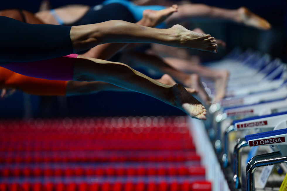Participants push off in the women's 200-meter freestyle swimming event.  AFP PHOTO / FRANCOIS XAVIER MARIT/AFP/Getty Images