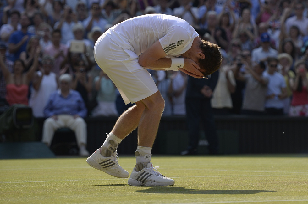 Britain's Andy Murray celebrates beating Serbia's Novak Djokovic during the men's singles final on day thirteen of the 2013 Wimbledon Championships. Murray won 6-4, 7-5, 6-4.  AFP PHOTO / ADRIAN DENNIS/AFP/Getty Images