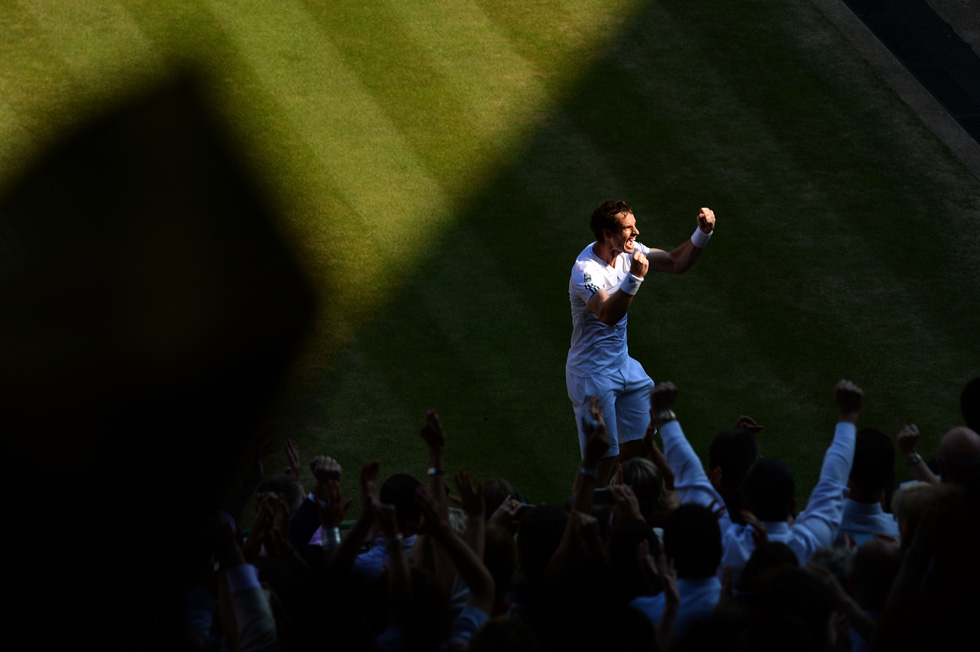 Andy Murray of Great Britain celebrates Championship point during the Singles Final match against Novak Djokovic of Serbia, July 7, 2013 in London, England.  (Photo by Mike Hewitt/Getty