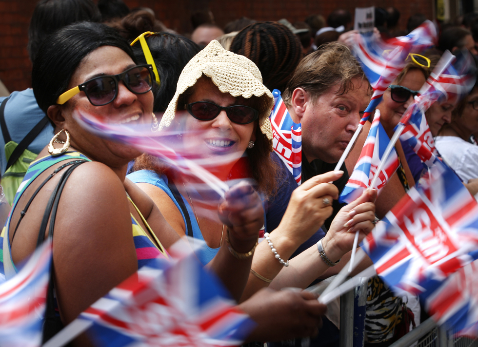 Royal fans wave Union flags as they wait for the royal couple to appear with their newborn son at St Mary's Hospital in London.   (Photo by Peter Macdiarmid/Getty Images)