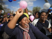 Thousands of people celebrate Nelson Mandela's 95th birthday outside his hospital in Pretoria.Christopher Furlong/Getty Images