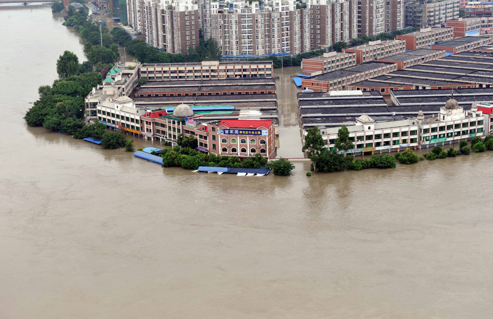 The Tuo river floods China's Sichuan province. Rainstorms have caused the worst flooding in decades, causing landslides that crushed homes and bridges, leaving villages completely cut off. AFP PHOTO/AFP/Getty Images