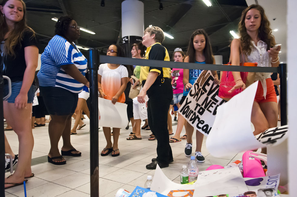 2013.07.18 - Hartford, CT - Fans attending Justin Biber's show at the XL Center toss placards in a trash pile after being told they were not allowed to bring them into the concert. Photograph by Mark Mirko | mmirko@courant.com