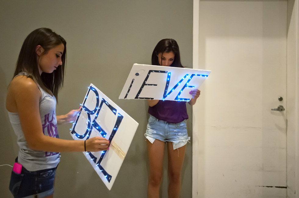 2013.07.18 - Hartford, CT - Vanessa Rosa and her twin sister Kassidy Rosa work on their homemade lighted BELIEVE signs before going into Justin Bieber's XL Center concert. Photograph by Mark Mirko | mmirko@courant.com