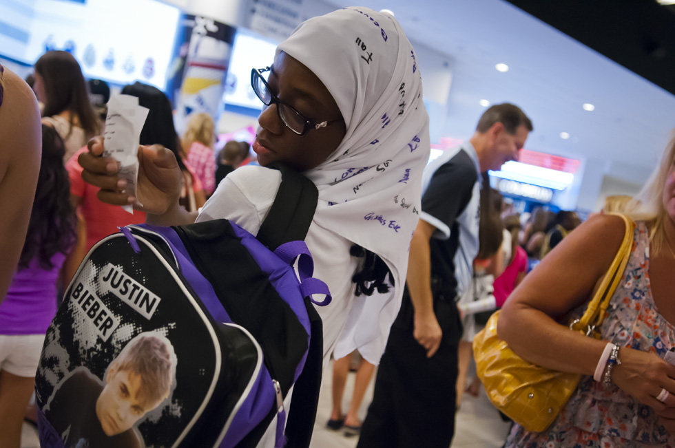 2013.07.18 - Hartford, CT - Wearing a scarf bearing names of Justin Bieber songs, 17-Year-old Tiana Shakir of Windsor adjusts her Justin Bieber backpack before going his XL Center concert. Photograph by Mark Mirko | mmirko@courant.com