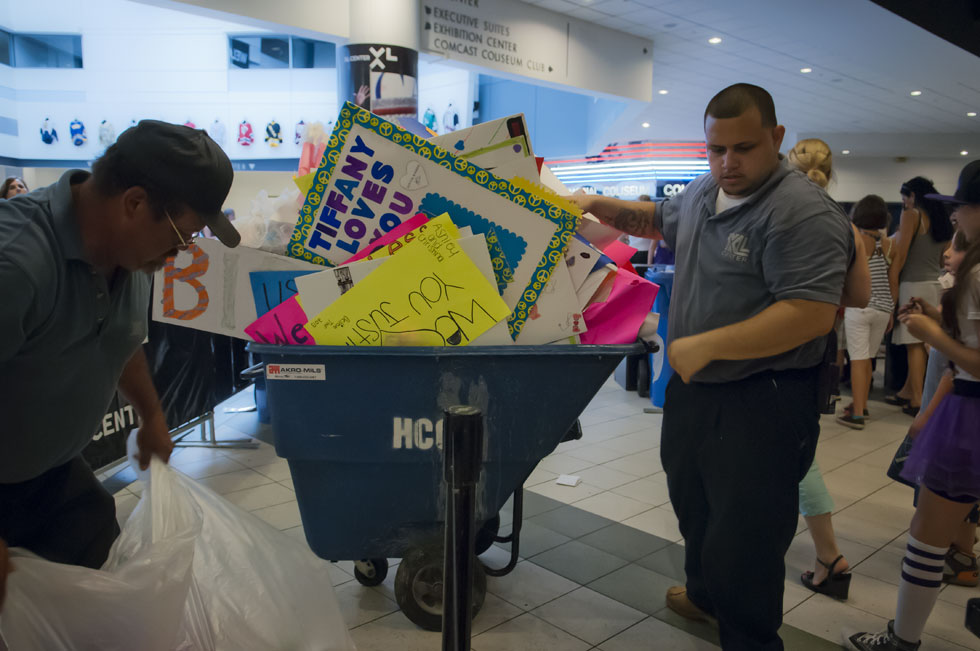 2013.07.18 - Hartford, CT - XL Center staff collect confiscated Justin Bieber placards and posters due to a prohibition on fans bringing them into his show. Photograph by Mark Mirko | mmirko@courant.com