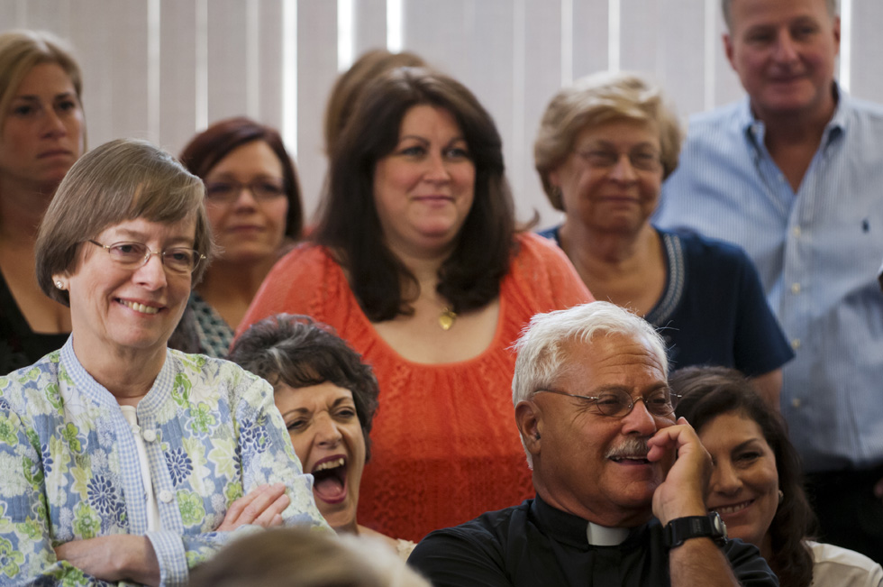 "2013.07.30 - Bridgeport, CT - People attending a press conference with Bishop Frank J. Caggiano laugh during one of the meeting's lighter comments. Caggiano, who was born on Easter, joked, ""The doctor never let me forget that I ruined his Easter dinner. ...right about the time pasta was going to be served.' Photograph by Mark Mirko 