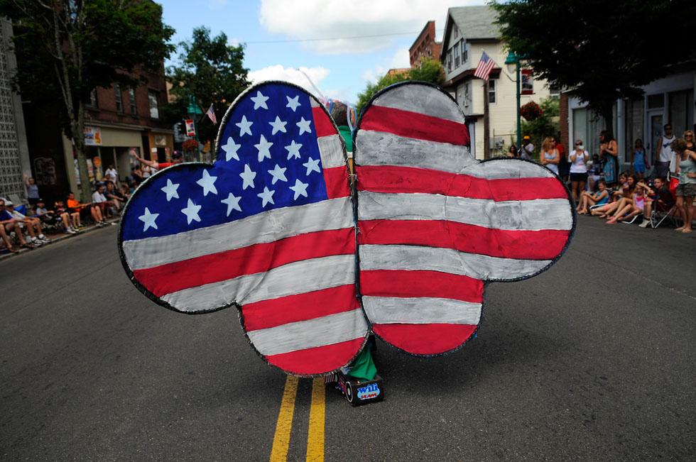 Wayne Norman, the color analyst for the Uconn Huskies, and WILI morning show host, leads the procession of the 28th annual WILI Boom Box Parade Thursday morning to celebrate the 4th of  July in Willimantic.