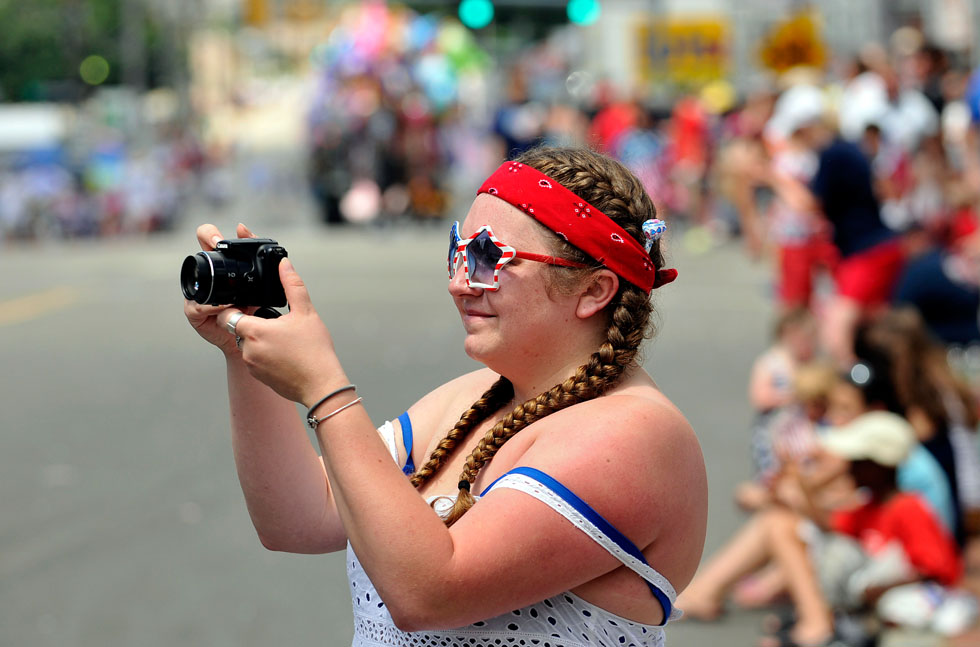 Stephanie Richard of Willimantic wore plenty of red, white and blue, even a pair of star shaped sunglasses while she took some video of the parade.