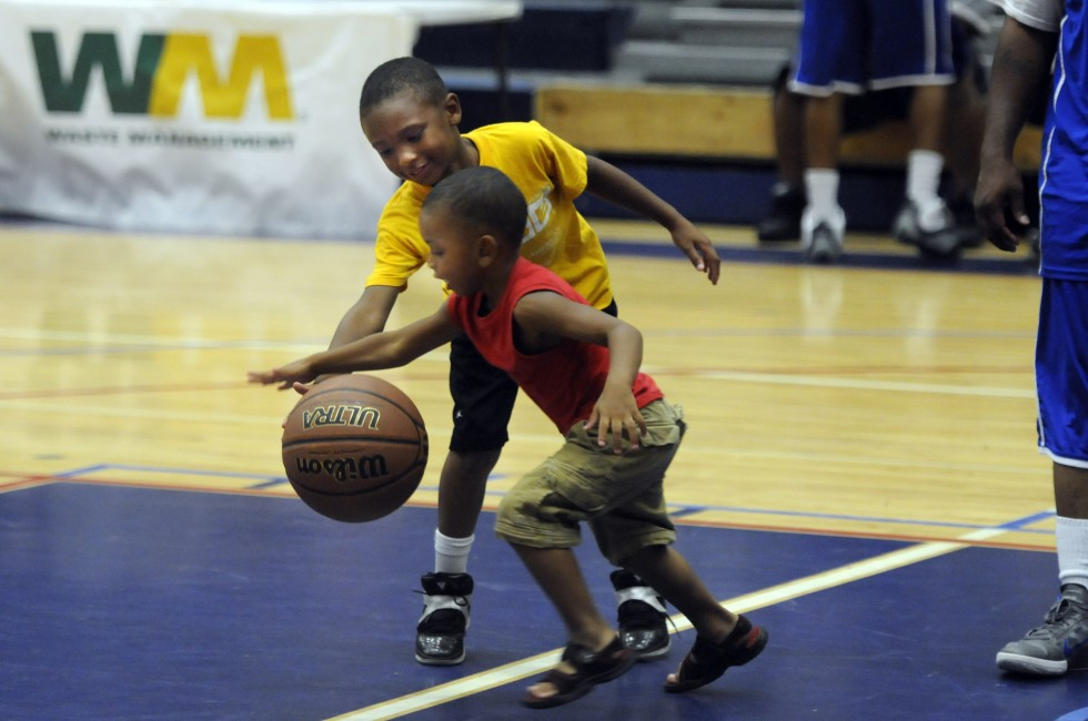 Jeydan Lee, 7 and his younger brother, Julien Lee, 5, take advantage of a timeout to get in a little playing time. The boys father, Roosevelt Lee, originally from New Britain now living in Waterbury, plays in the league.