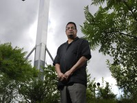 Geraldo Reyes Jr. the mayor of Waterbury's Admin. Aide, grew up in the same neighborhood as Holy Land in Waterbury, and has fond memories of playing at the theme park as a child. He posed for a photo near the current cross which is fixed at the same location of older larger cross, which was more visible.
